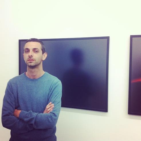 Yaniv Yeudah Eiger in front of a wrok by Guy Criden